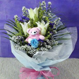 3 White Lily & 1 Blue Rose With Bear at centercenter
