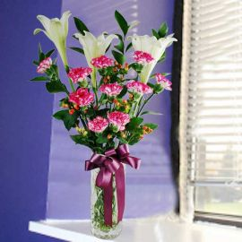 3 White Lilies & 10 Pink Carnations in Glass Vase.