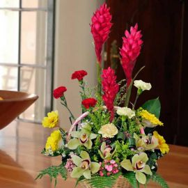 Cymbidium orchids with Red Ginger flower table arrangement